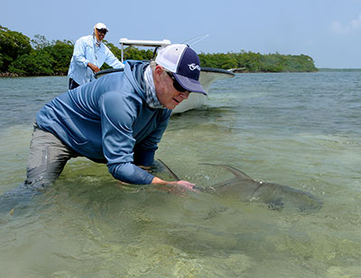 Catch and Release of a permit while fly fishing in Belize