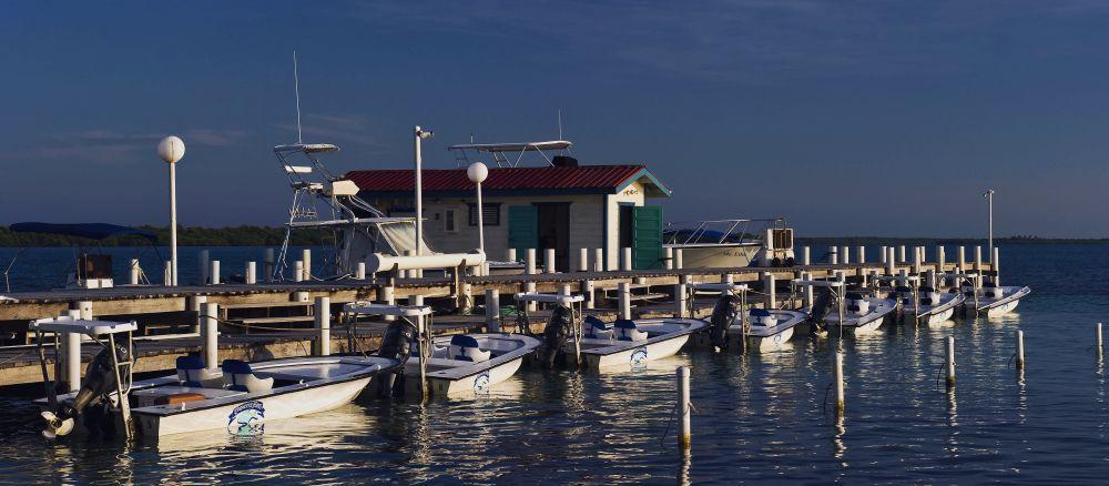 Belize permit fishing lodge, fishing skiffs.