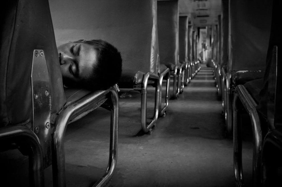 A homeless boy sleeping inside the train by Budi Prakasa.