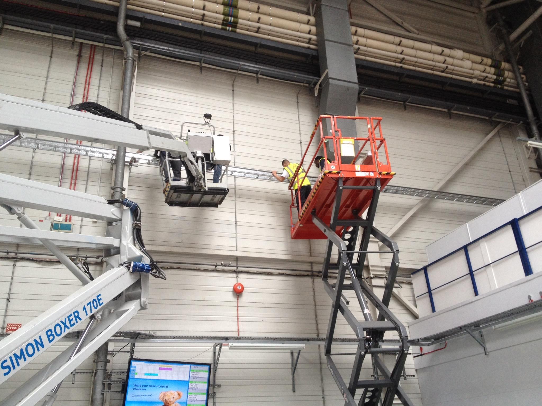 Laddre racking from genie lift.jpg