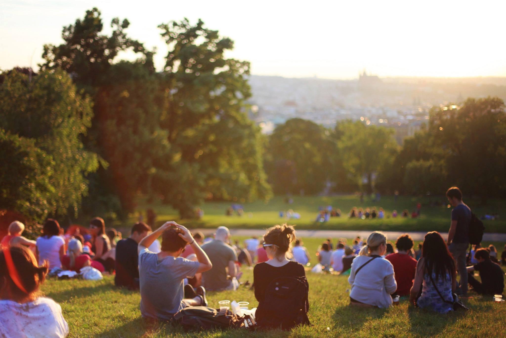 people sitting on grass watching sunset.jpeg