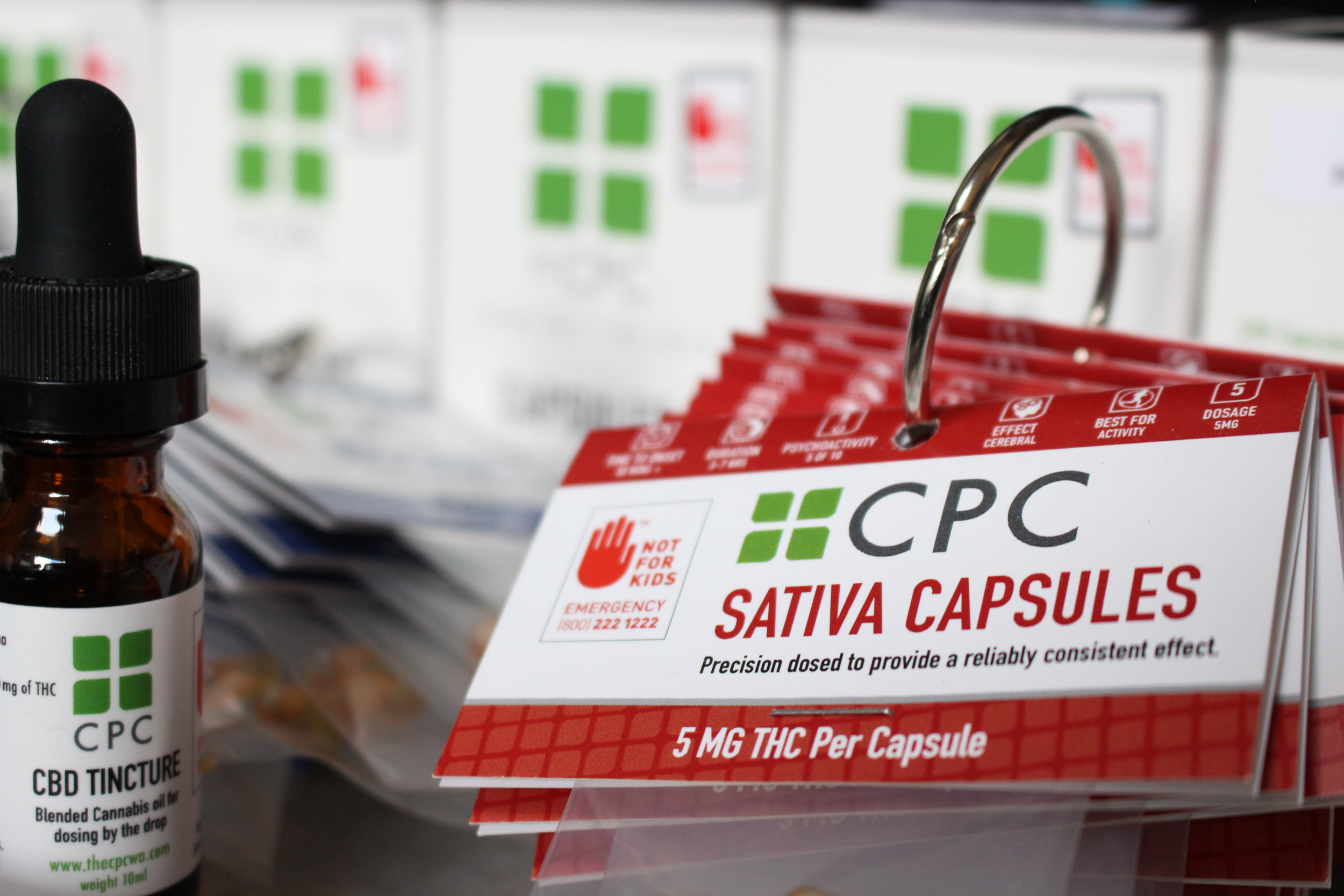 CBD Tincture and Sativa Capsules Cannabis packaging.jpg