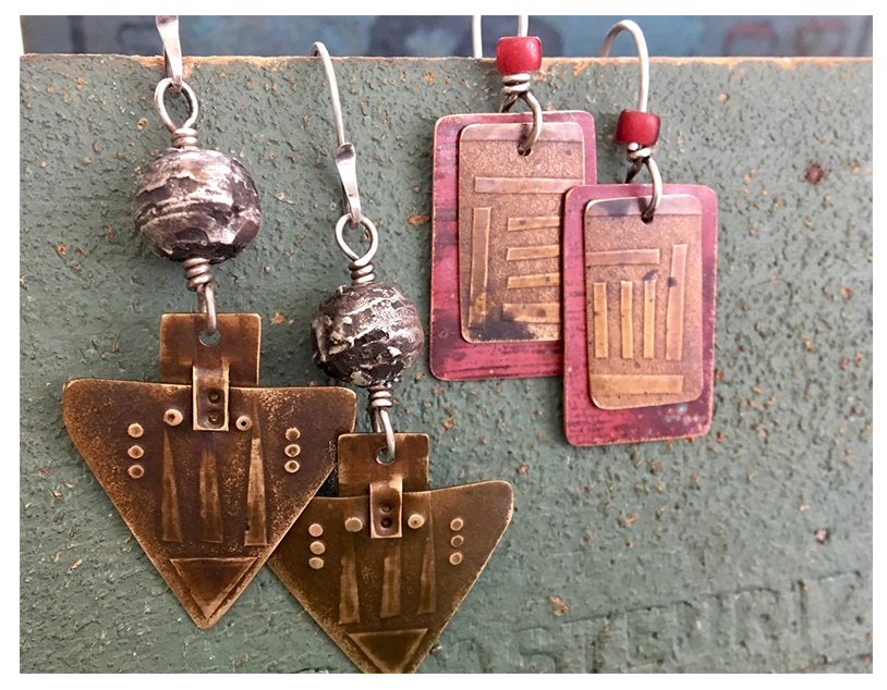 Examples of roll printed earrings with rivets and stampings.