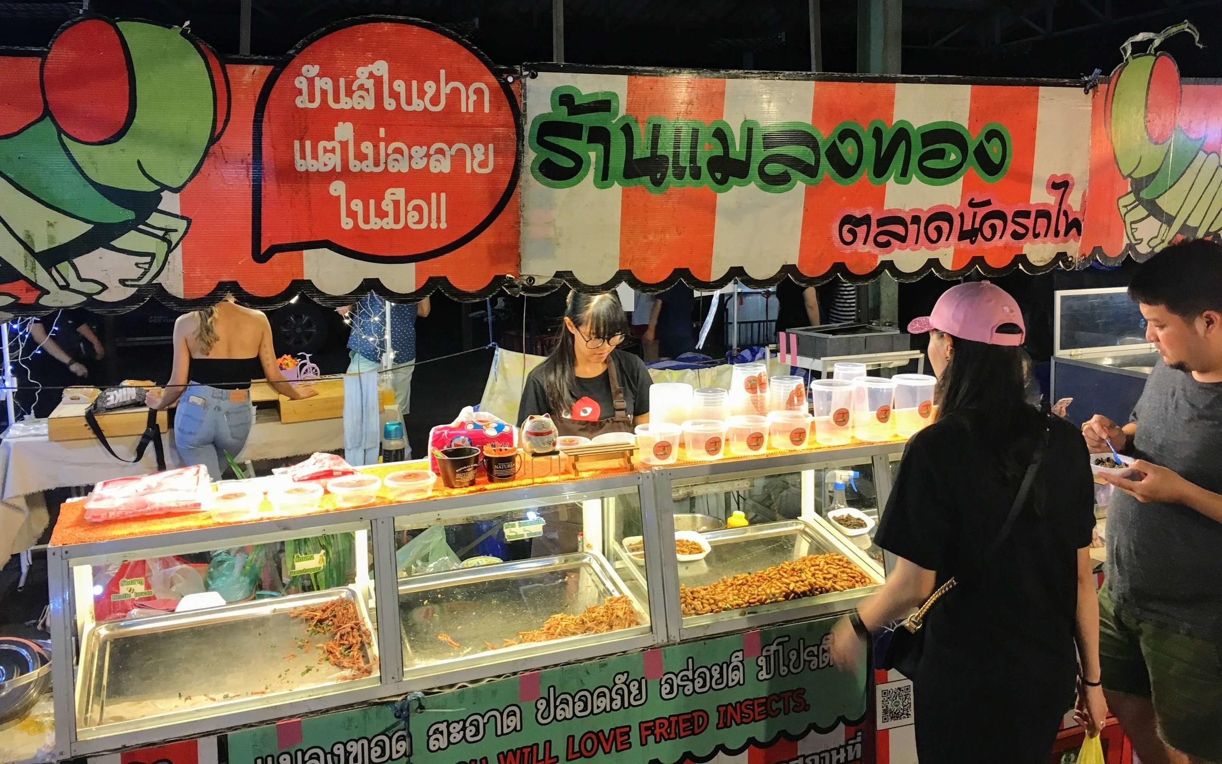 Fried insect vendor at Rod Fai night market in Bangkok.