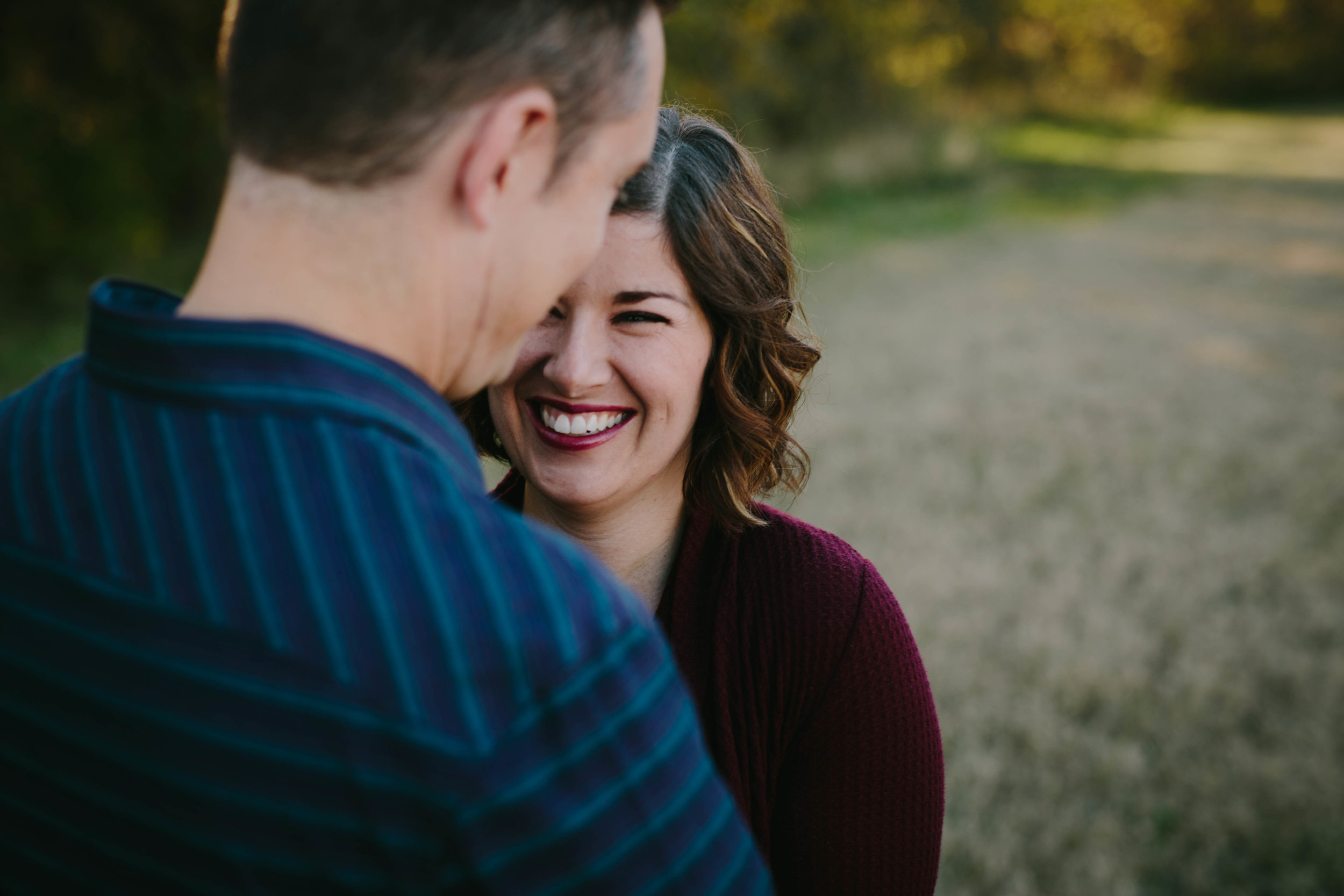 Mom and dad laughing together | AK family photographer