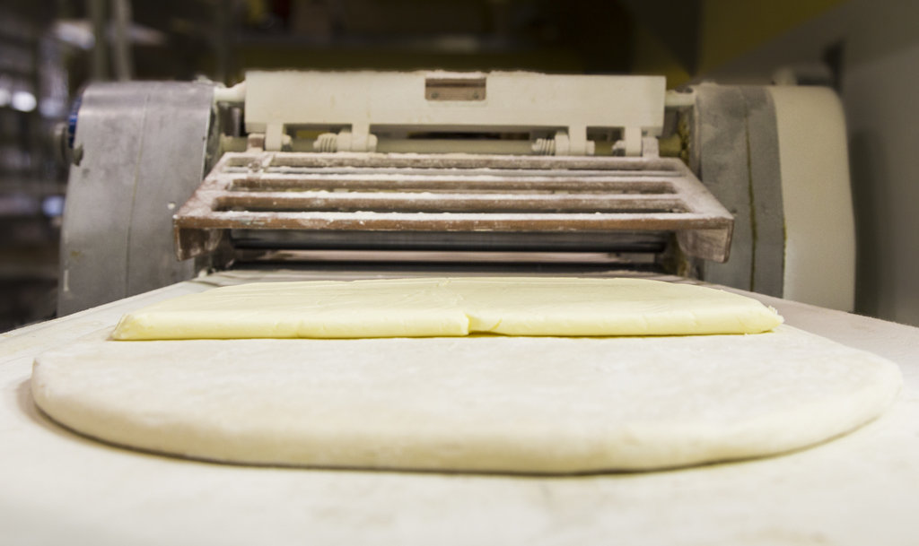 A butter sheet before being folded inside and rolled