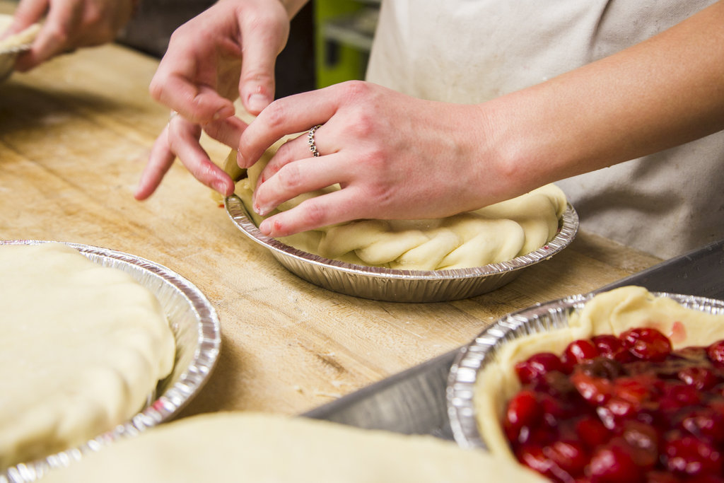 The dough is folded by hand to give the nice, firm edges of the pie.