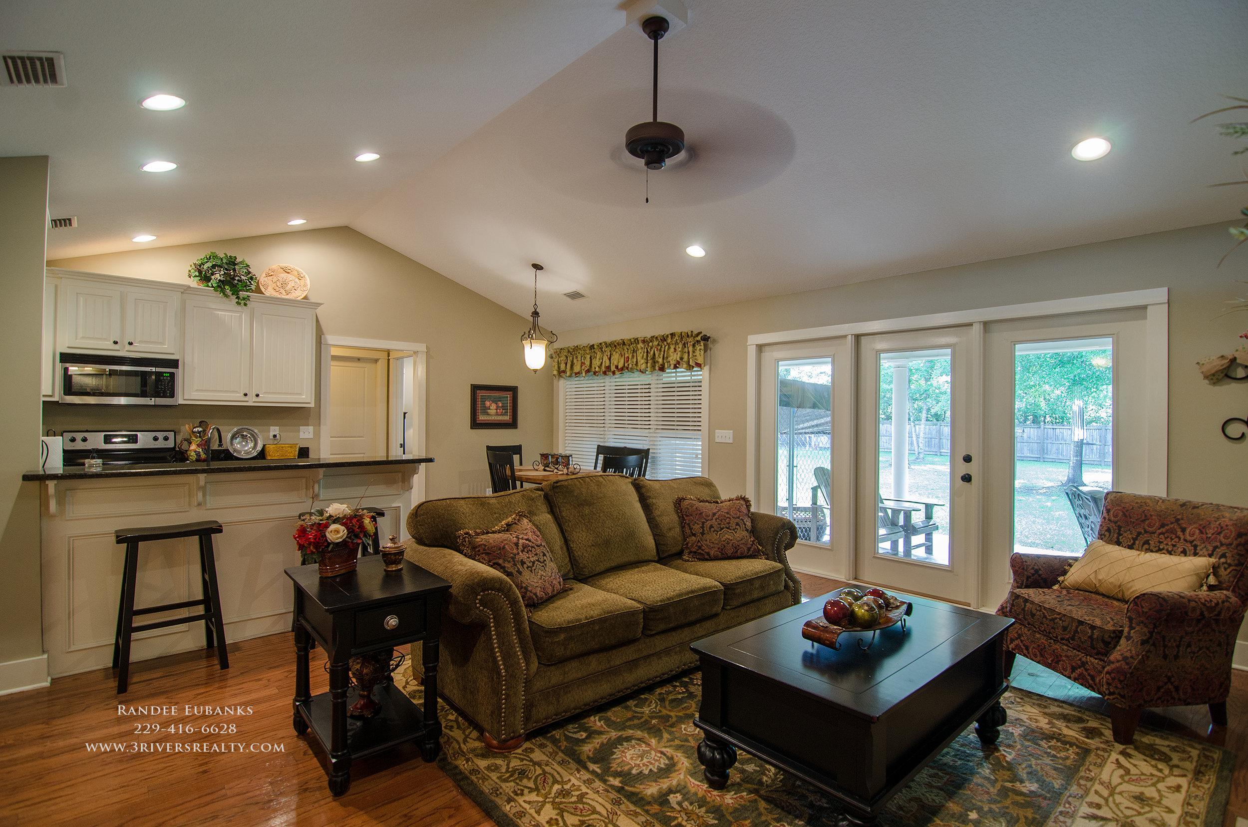 3riversrealty_bainbridge-georgia-home-for-sale_3-bed-2-bath_outdoor-fireplace_three-rivers-realty_mills-brock_TaurusUSA_pool_back-porch-fireplacae_livingroom_kitchen - Copy.jpg