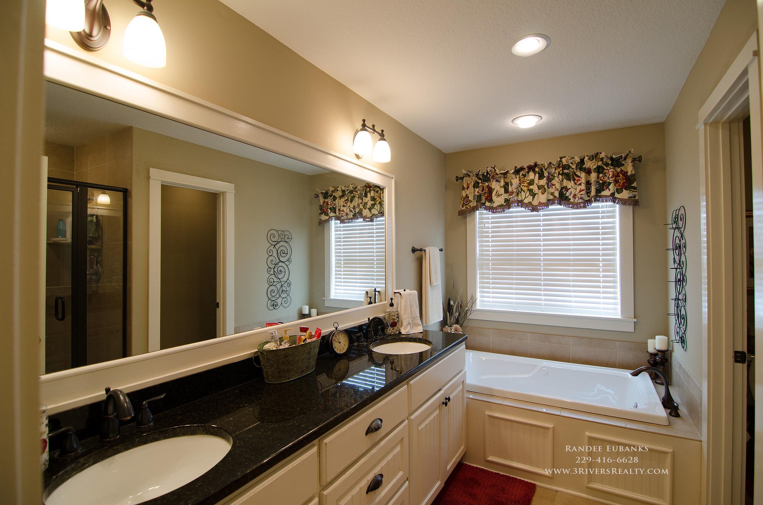 3riversrealty_bainbridge-georgia-home-for-sale_3-bed-2-bath_outdoor-fireplace_three-rivers-realty_mills-brock_Taurus-USA_-pool_back-porch-master-bath - Copy.jpg