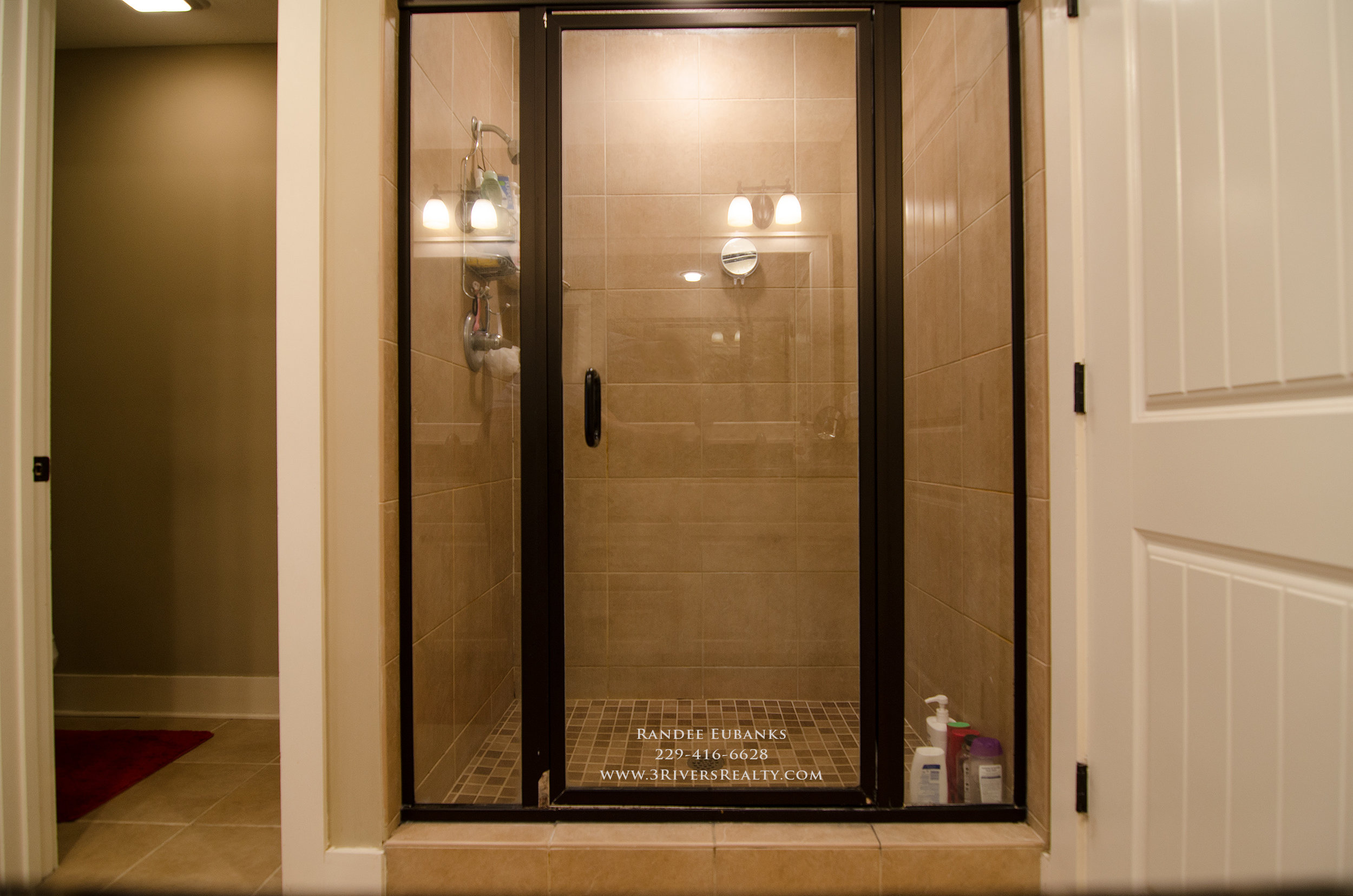 3riversrealty_bainbridge-georgia-home-for-sale_3-bed-2-bath_outdoor-fireplace_three-rivers-realty_mills-brock_Taurus-USA_-pool_back-porch-master-bath-shower.jpg