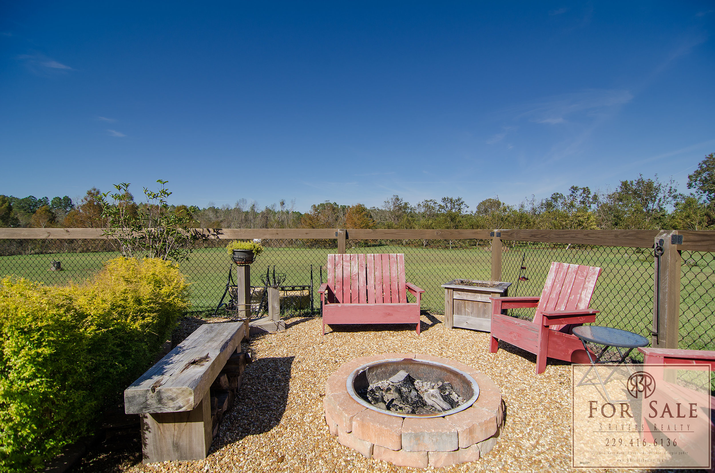 Fire Pit by Pool Deck - Spend the evenings by the fire while you watch the big screen on the porch.