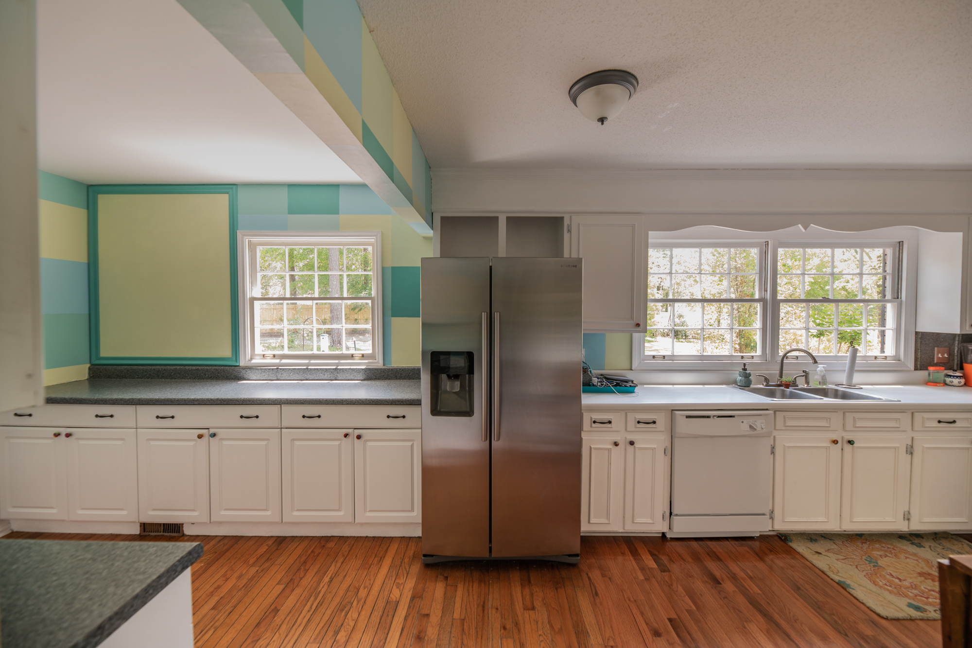 Open floor plan interior that features a spacious kitchen that opens into the den. -
