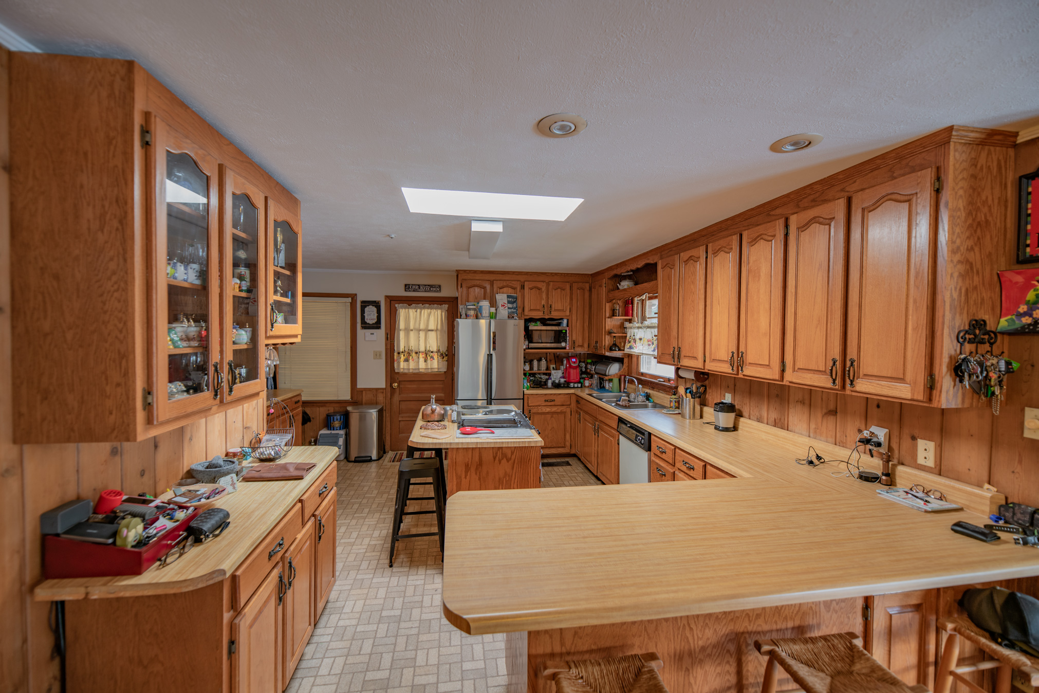 Open floor plan interior that features a spacious kitchen that opens into the den and the office/study -