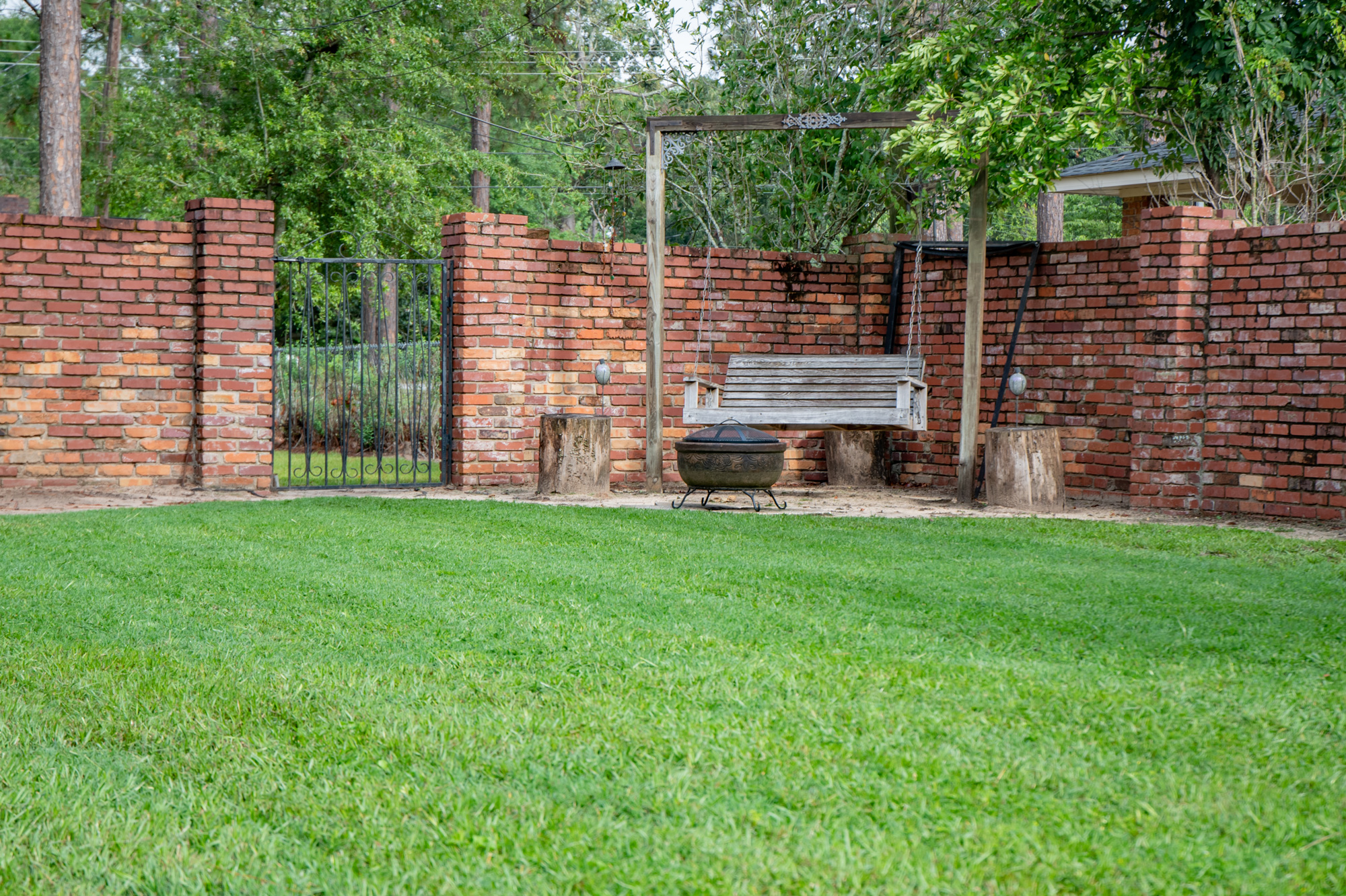 Secluded backyard garden - The brick privacy wall that encloses the entire back yard provides seclusion and safety.