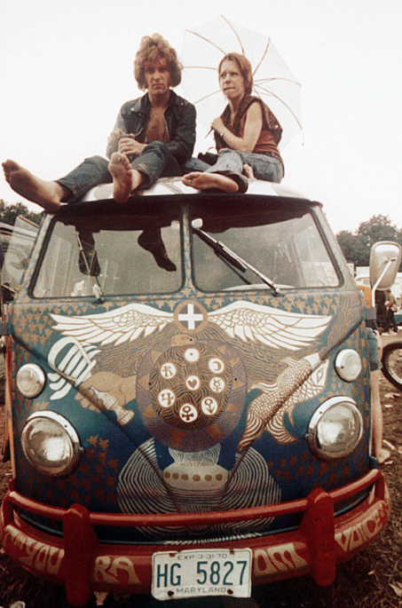 Concertgoers sit on the roof of a Volkswagen Bus at the Woodstock festival in Bethel, N.Y., in mid-August 1969. (Associated Press)