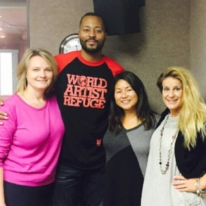 Doris with Morris Peterson Jr. and SuperTalk 157o Co-hosts Candice Montie (left) and Kristen Wolosonowich (right).