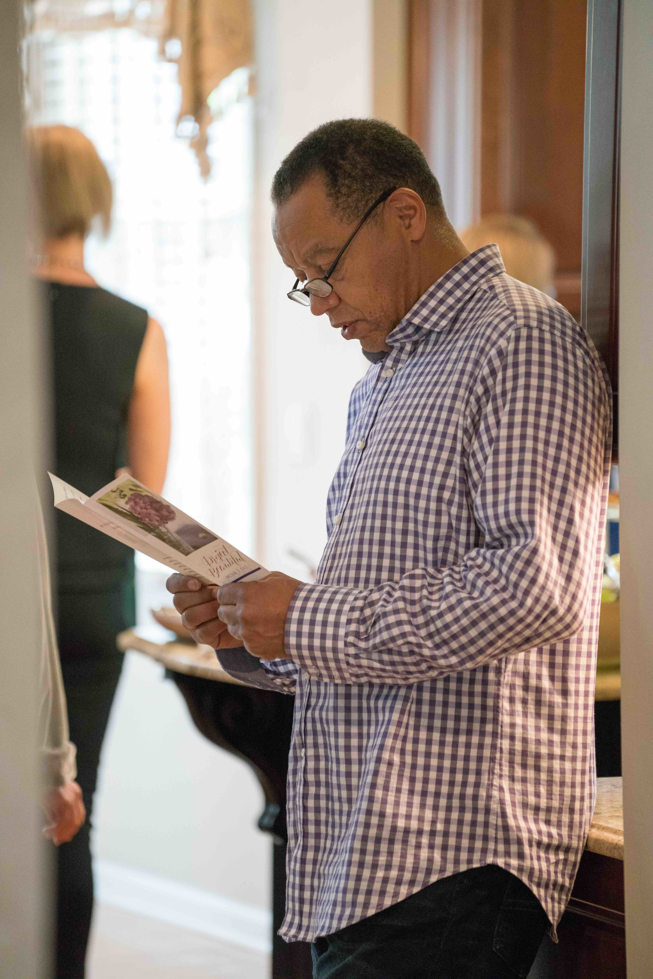 Board member Allison Martin's husband, Harold, reading up on Project Beautiful!