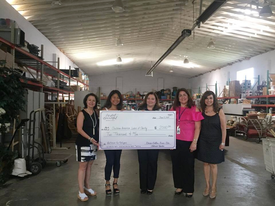 $2000 Check Presentation to United Community Family Services!