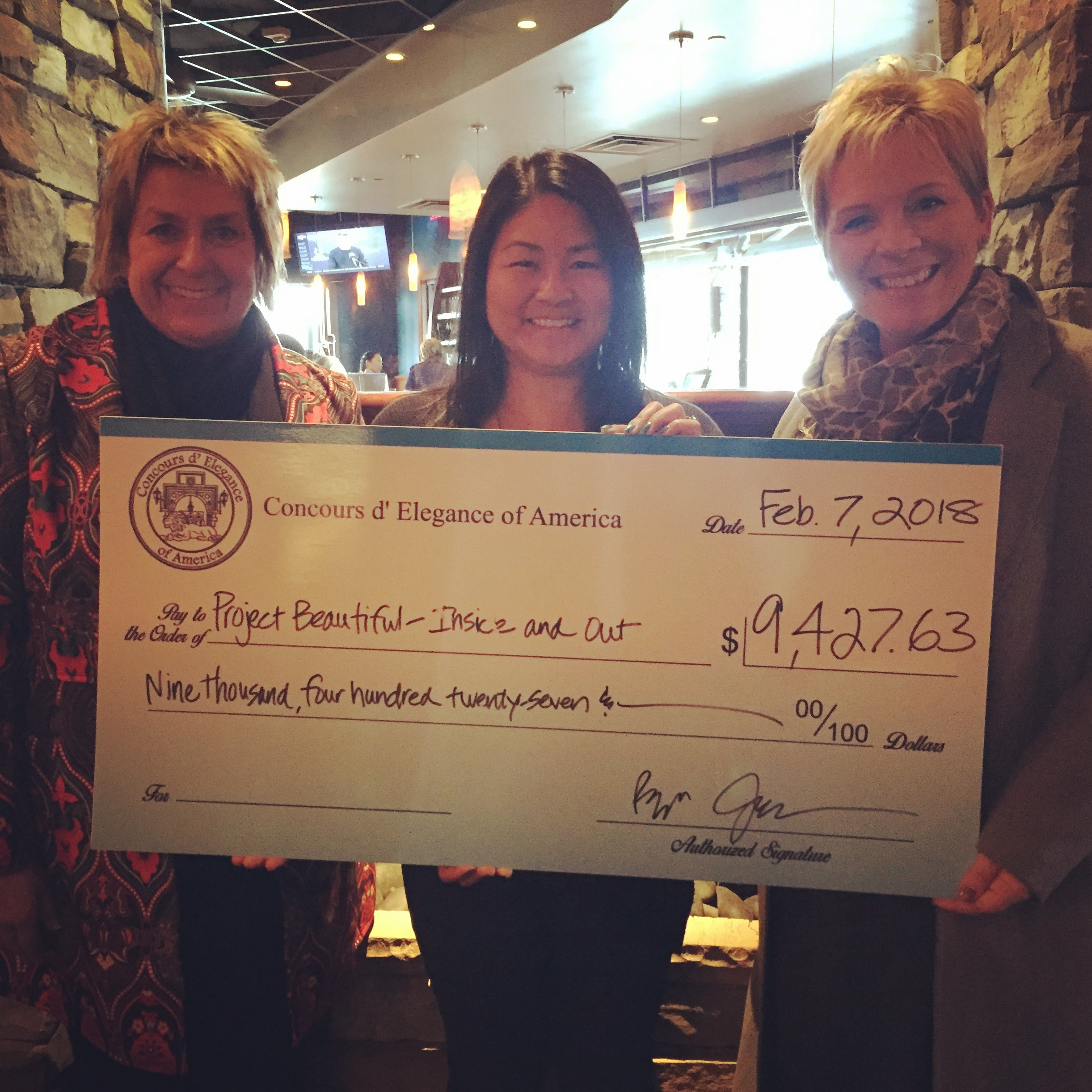 Concours Executive Director, Diane Flis-Schneider (left), and Events and Operations Coordinator, Tara Noftz (right), present donation check to Project Beautiful Executive Director, Doris Gilles (center).