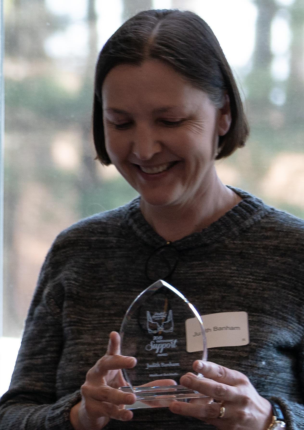 Judith Banham chuckling about her award featuring a bra!  PC: John Keep.