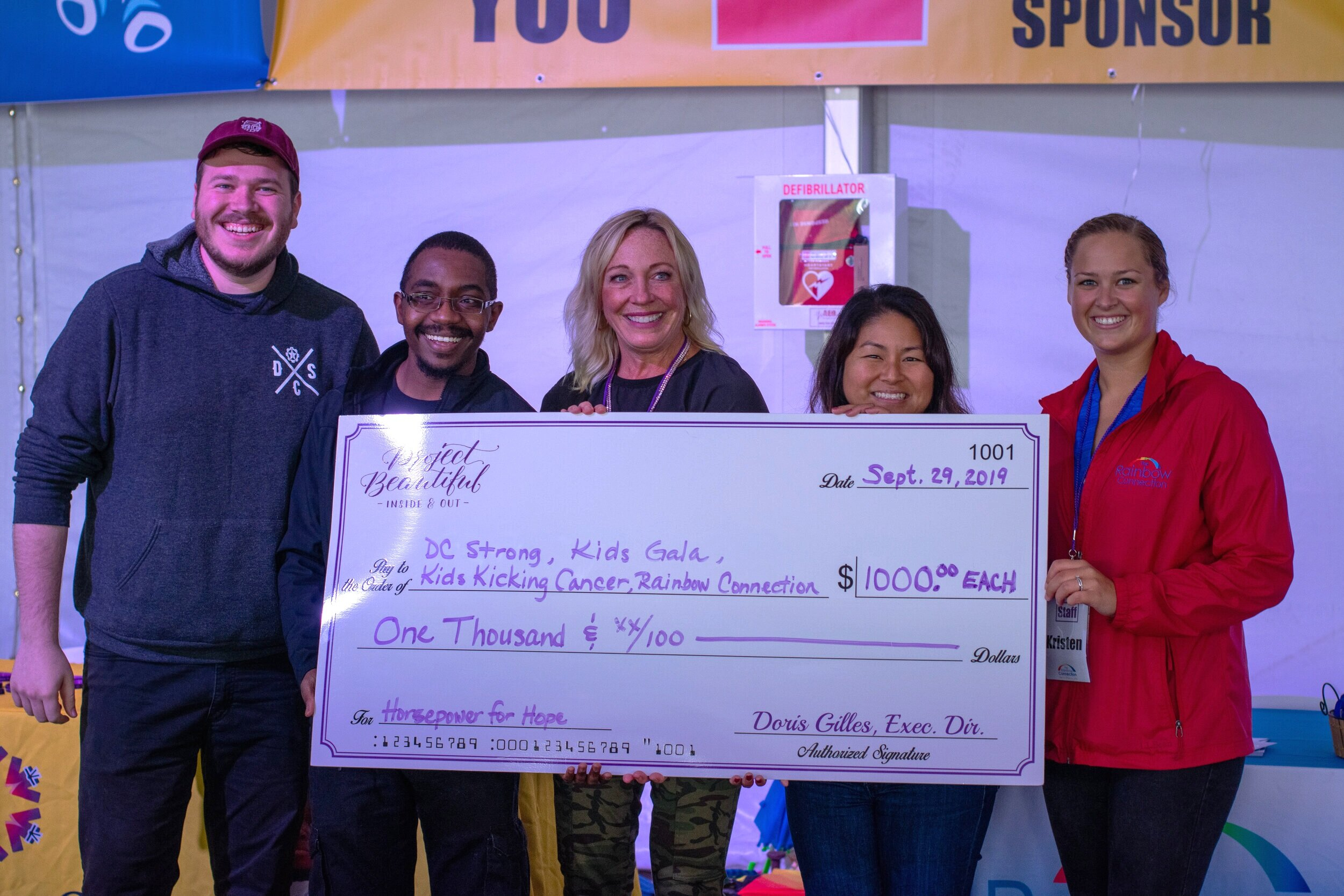 Project Beautiful Executive Director, Doris Gilles (2nd from right) presented each organization with a $1000 check to continue their amazing work!