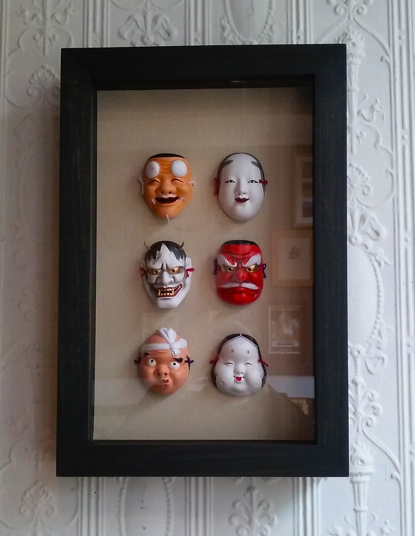 BLACK STAINED ASH FRAME  MASKS FLOATED ON CREAM MATTE