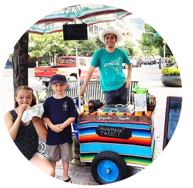 Miguel Cobos at the original cart with a couple of satisfied customers