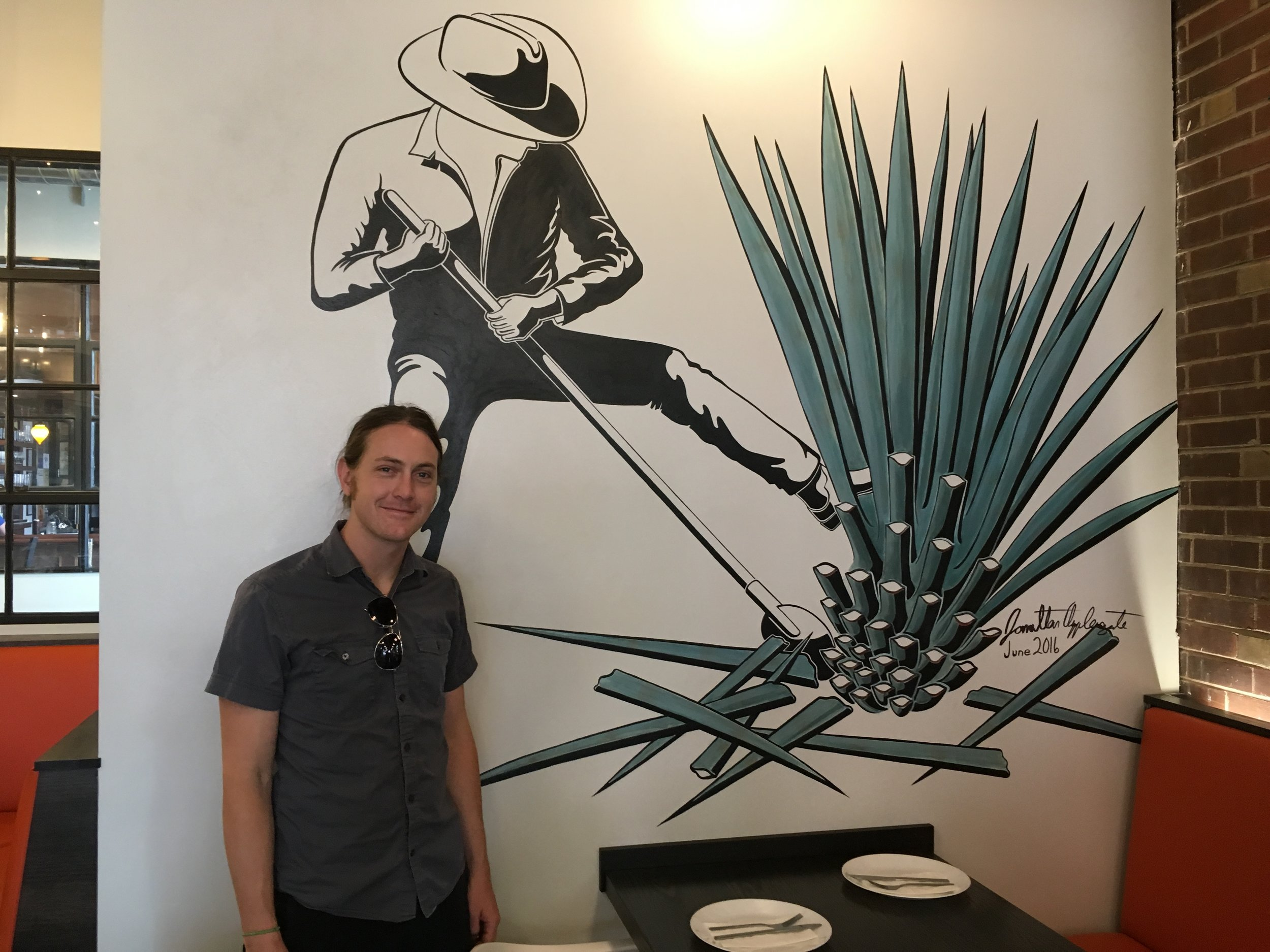 Jonathan Applegate and Mas Kaos Mural.JPG