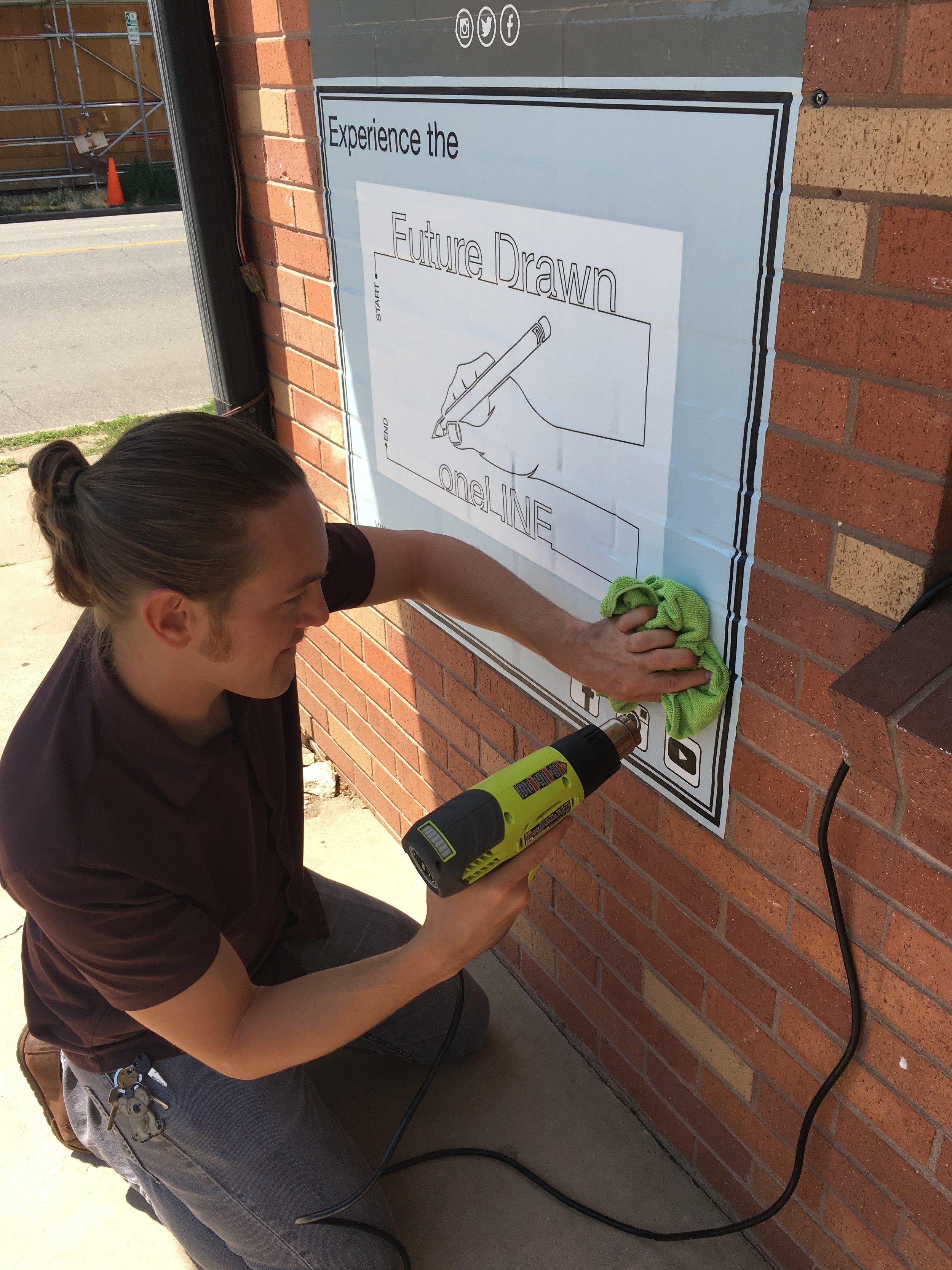 Jonathan Applegate Future Drawn getting the sign ready.JPG