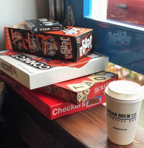 Games in the store include: - Connect Four, Jenga, Scrabble, checkers, and playing cards.