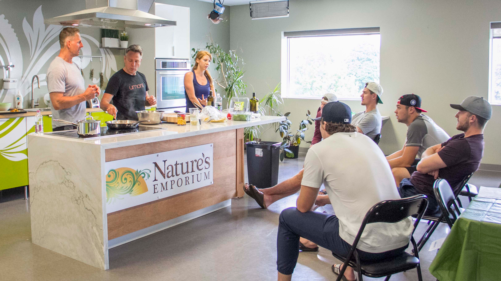 Andrew-with-Gary-and-Athletes---Nature's-Emporium.jpg