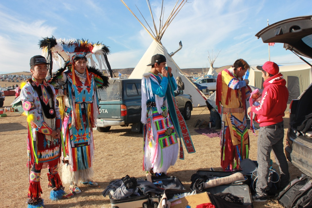 Young Navaho men Brandon Beguy, Kenneth Shirley, Ty Lodgepole and Turtle Owens, of a dance group they call Indigenous Enterprise, prepare for a performance.