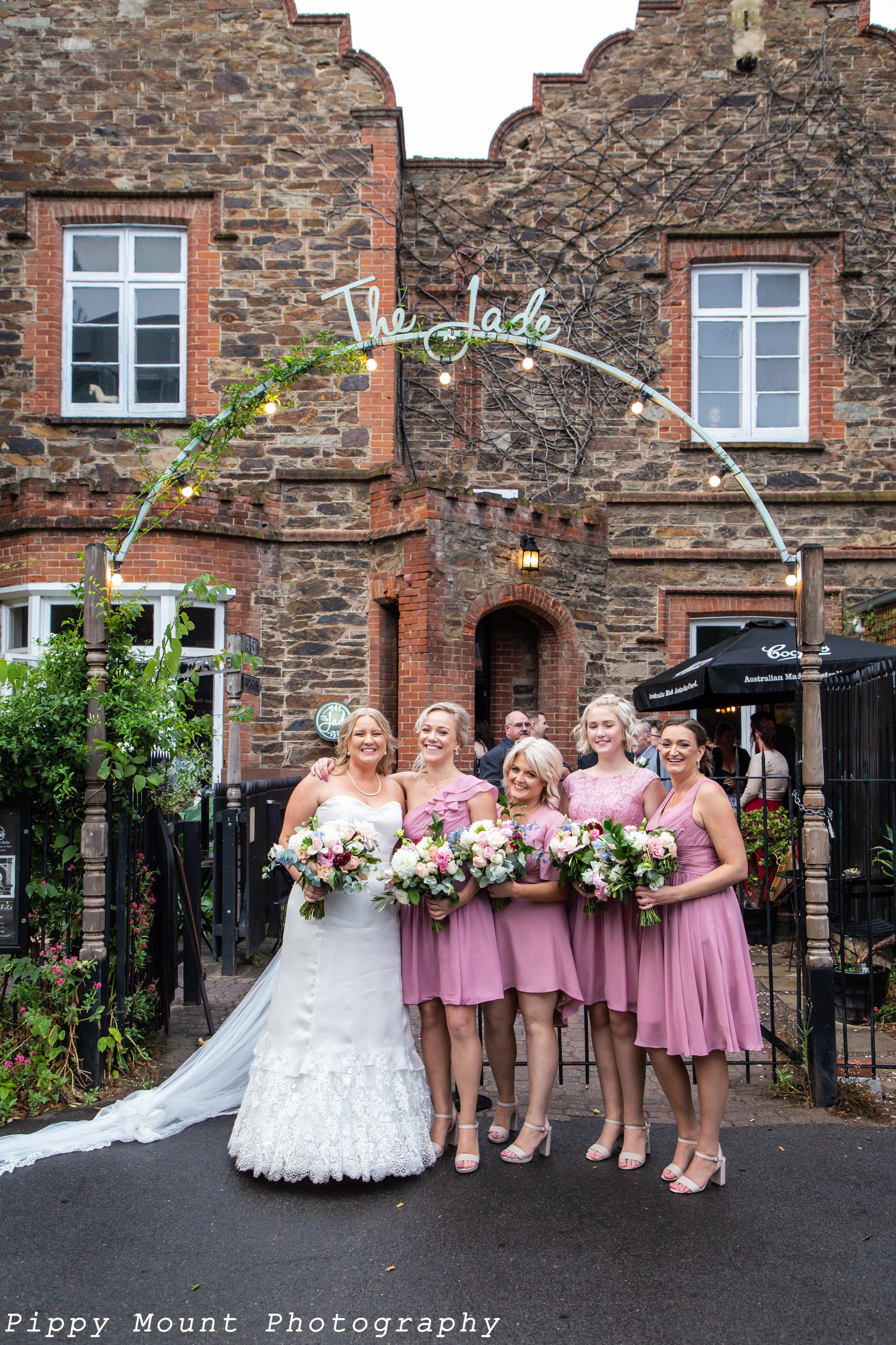 E&S wedding - Bride & bridesmaid under sign copy.jpg