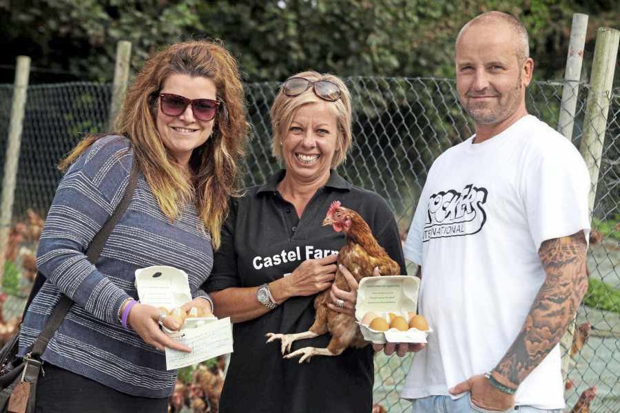 CASTEL FARM EGGS - big thanks to Emma Brooks and the team at Castel Farm Eggs who donated 5p for every box of eggs sold over a three-month period.  Raising a whopping £4,125.00  Sonia and Geoff with Emma Brooks (Centre)