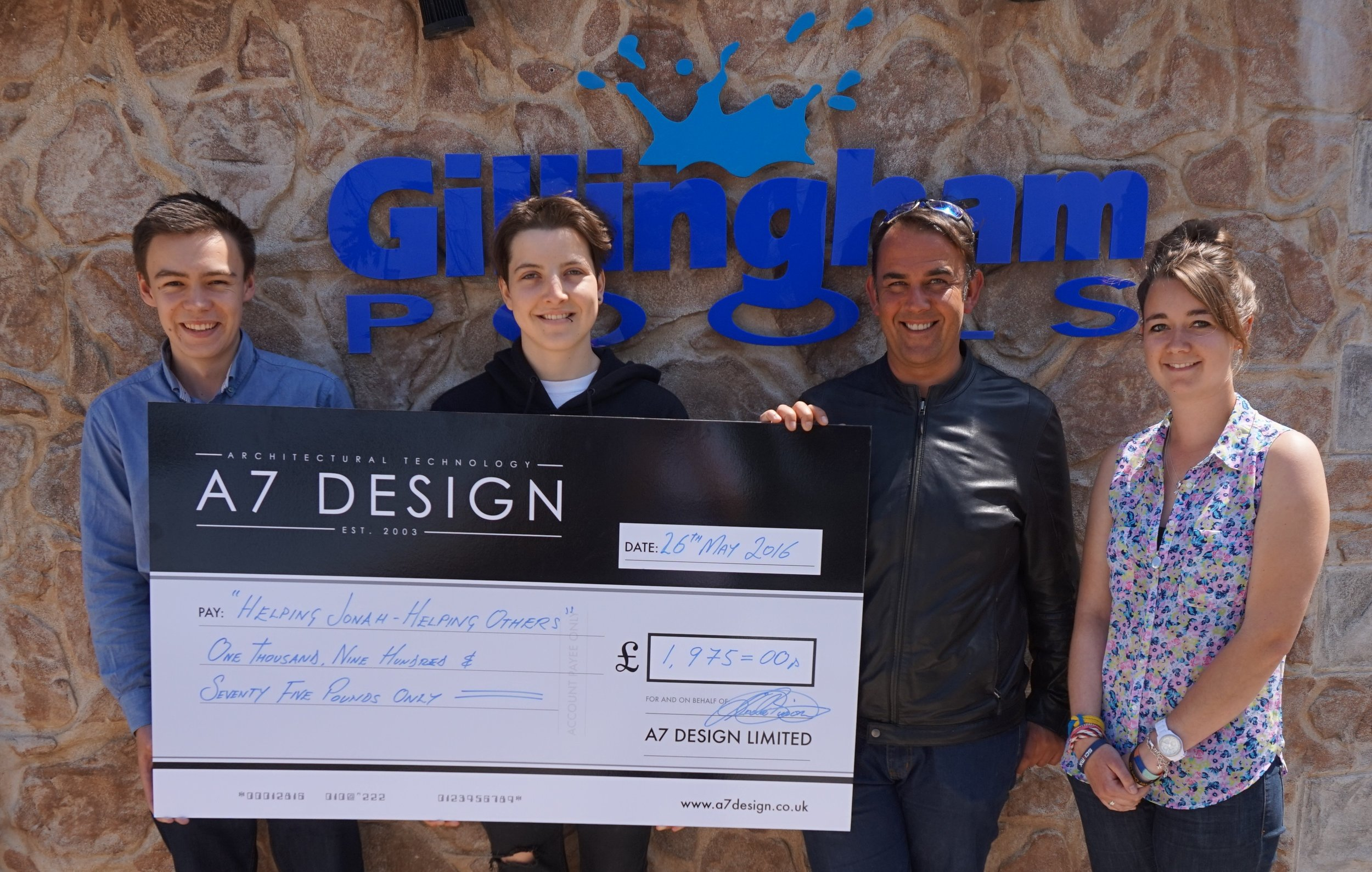 A7 DESIGN - thanks to the team at A7 design for raising an amazing £ 1,975.00 through their donation scheme.  Jonah 2nd left with Andre Bisson 3rd left and Team