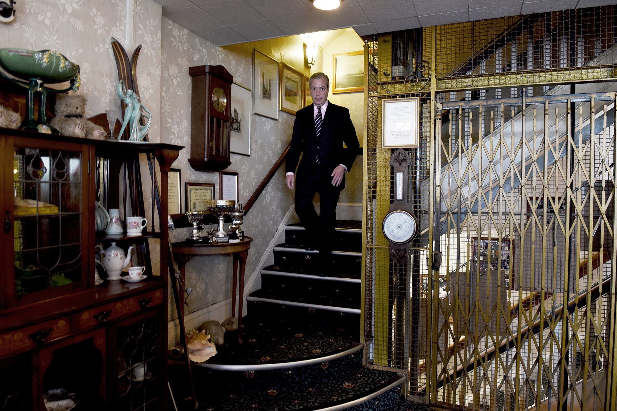 Nigel Farage descends the stairs of the Walpole Bay Hotel where he spent the night of the election count as it became apparent that he would not win the South Thanet seat. May 8th 2015