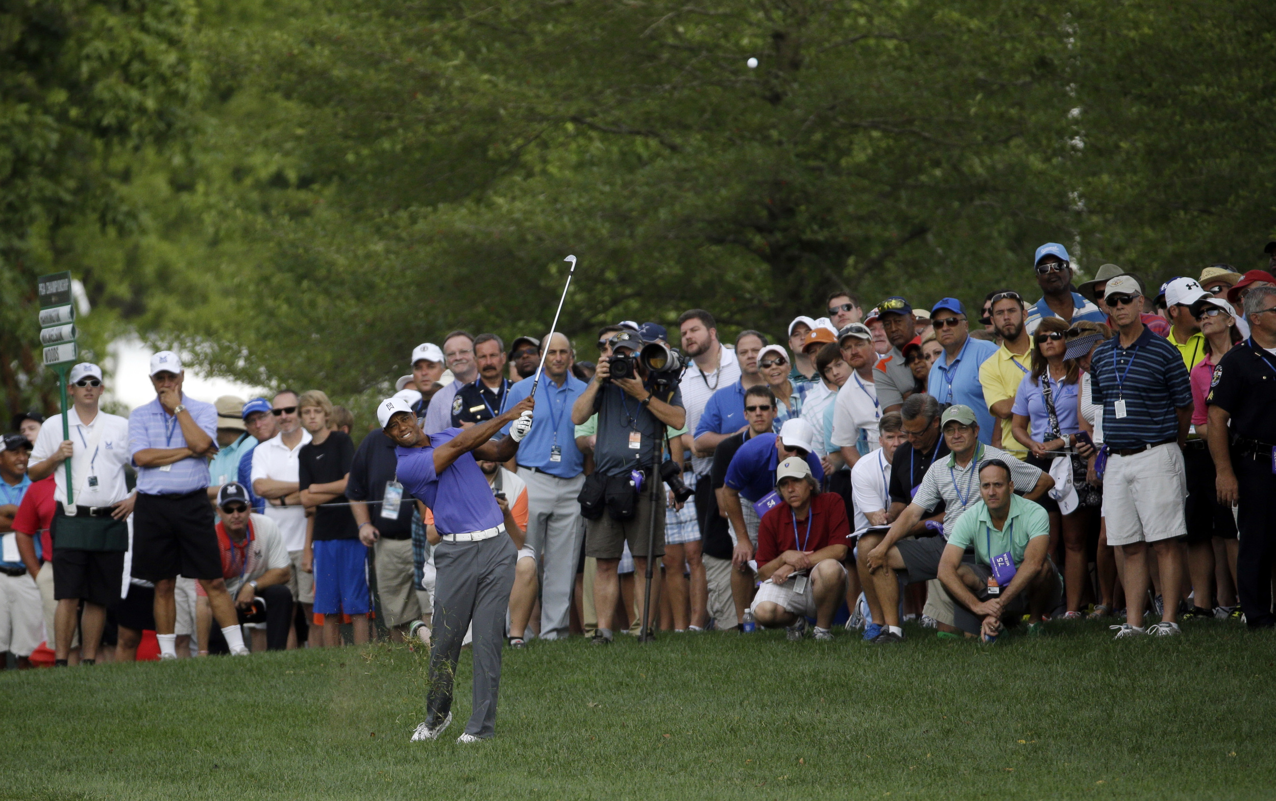 My day job is as an editor at Golf Digest. That's me (front right, green shirt) shadowing Tiger Woods at the PGA Championship.