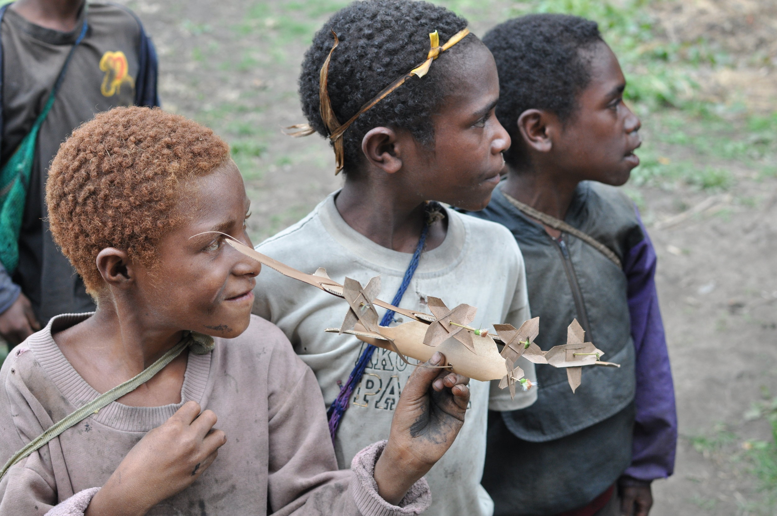 Boys with a home-made model airplane. Gua, 2009.