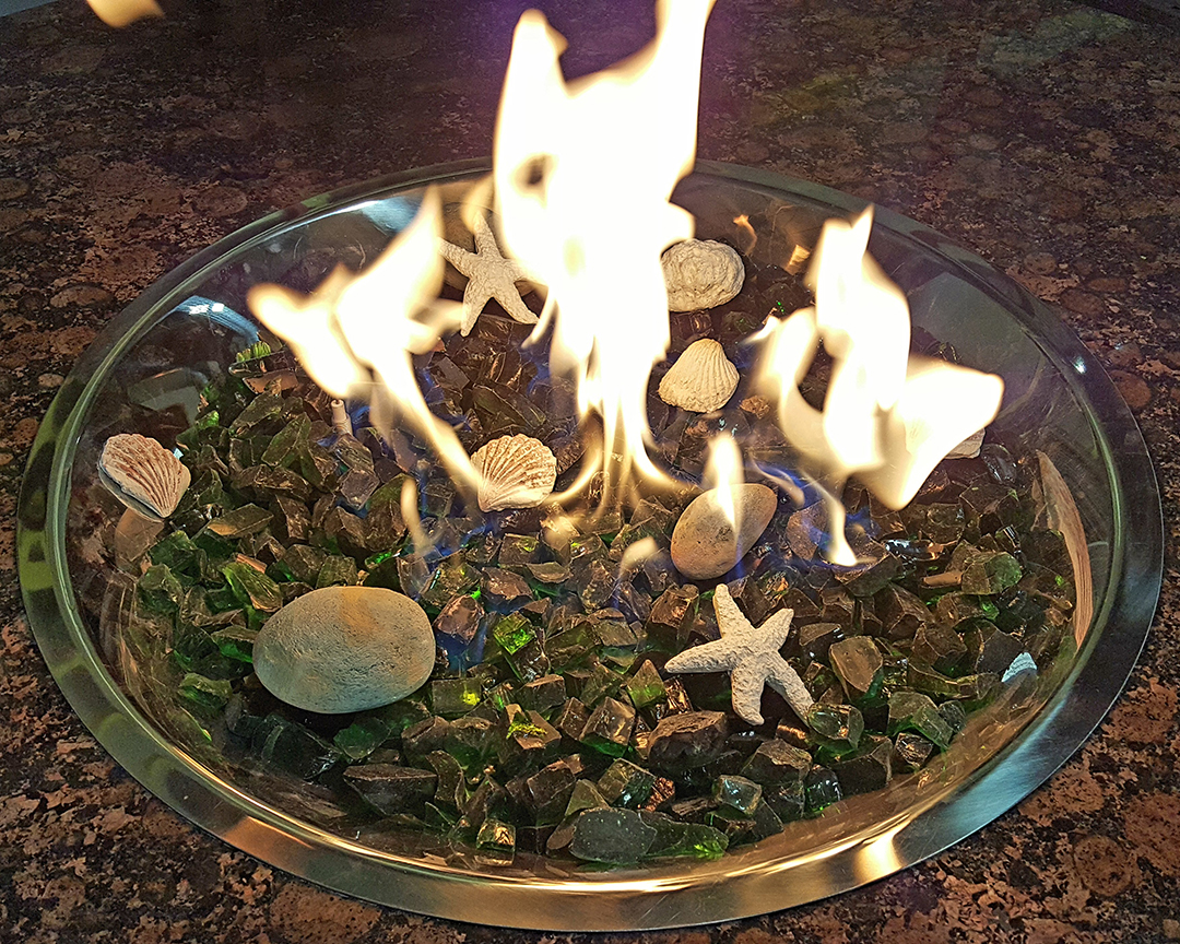 Emerald glass with Shells starfish & stones burning