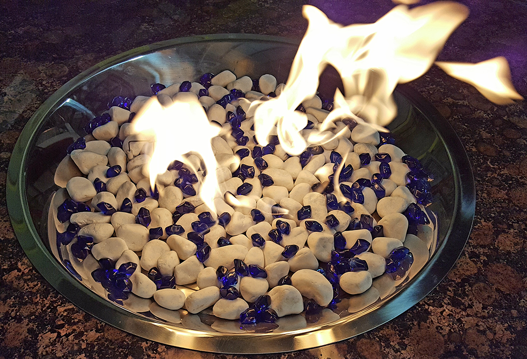 White marble  stone sprinkeled with sapphire jelly beans burning