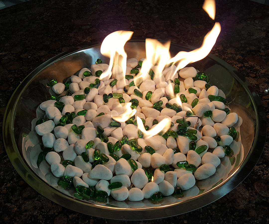 White marble  stone sprinkeled with emerald jelly beans burning