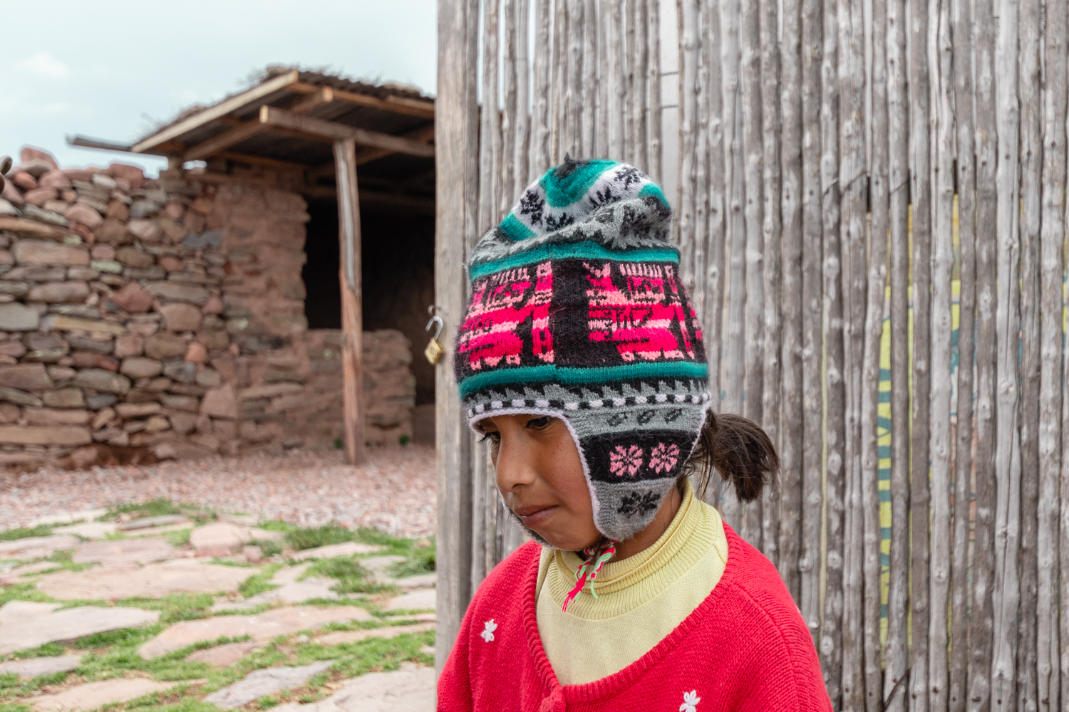 Younger children help sustaining the family, selling handicrafts to tourists around the ruins.