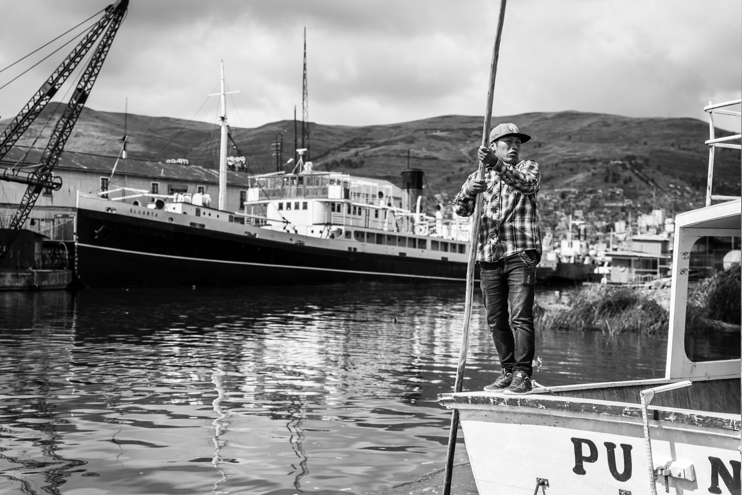 A sailor is ready to take off as he carries locals and tourists from the city of Puno to the islands. Tourism on lake Titicaca has become a decent source of revenues for a lot of families, as the fishing industry is collapsing.