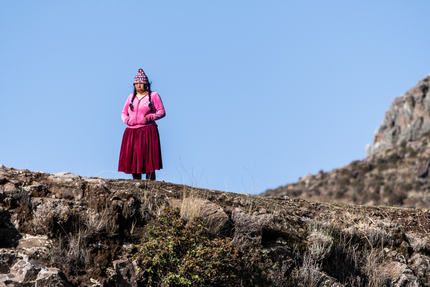 The Aymara-speaking islanders are distinct from most of the surrounding Quechua-speaking island communities and maintain a strong sense of group identity.