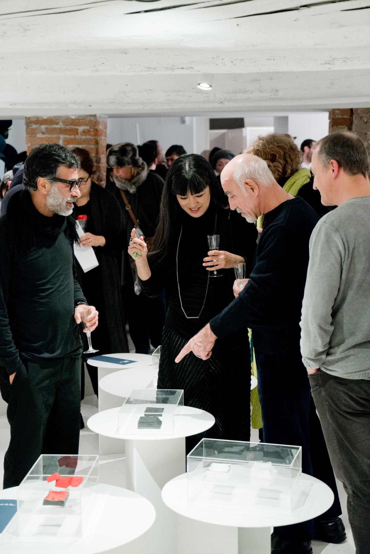 Opening of  Selected Stories , Corrado De Meo explaining his work to Pietro Pellitteri, Yoko Takirai and Sergio Spivach, 2016, OHMYBLUE, Venice, Italy
