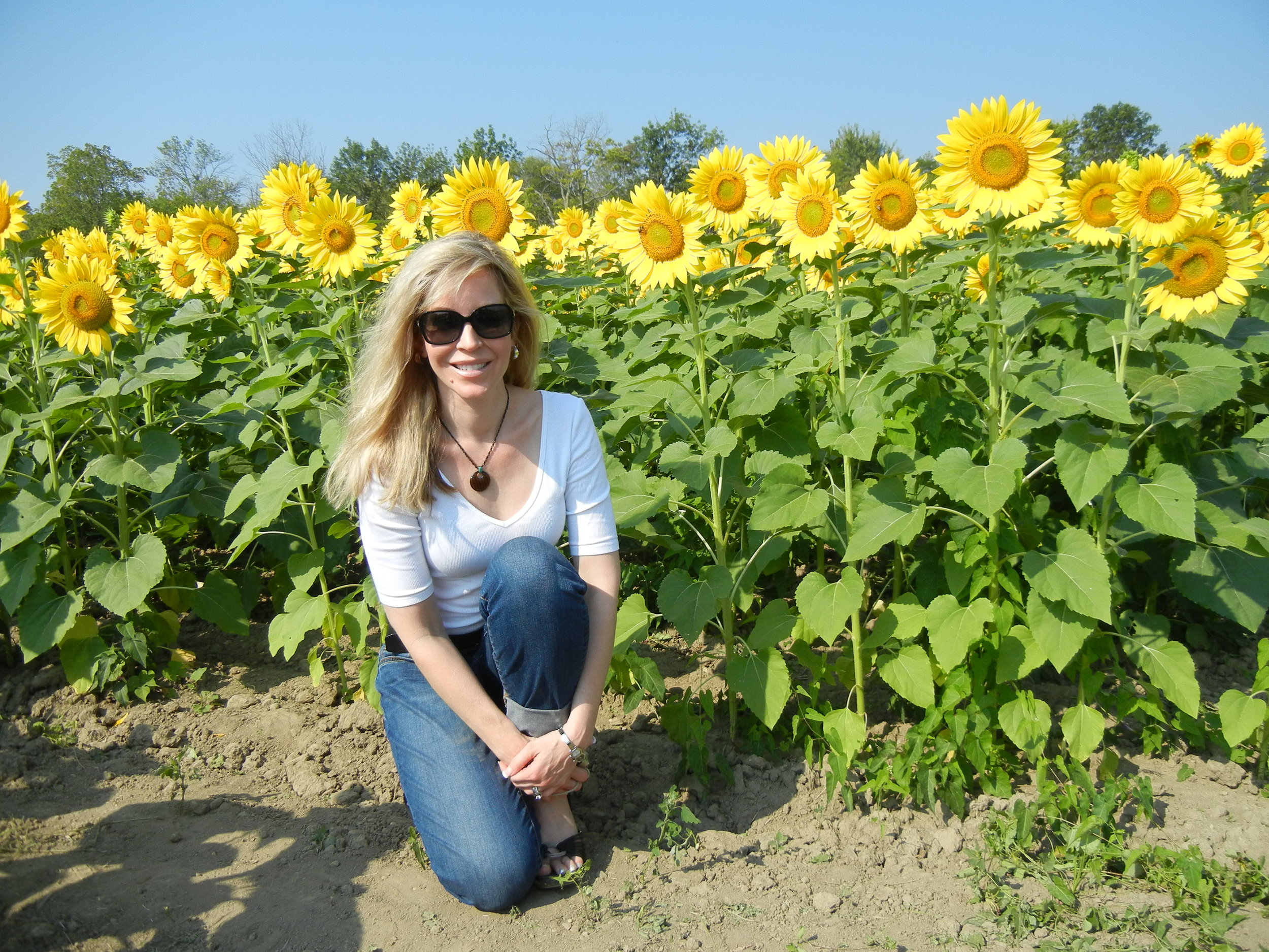Mama in sunflowers.JPG