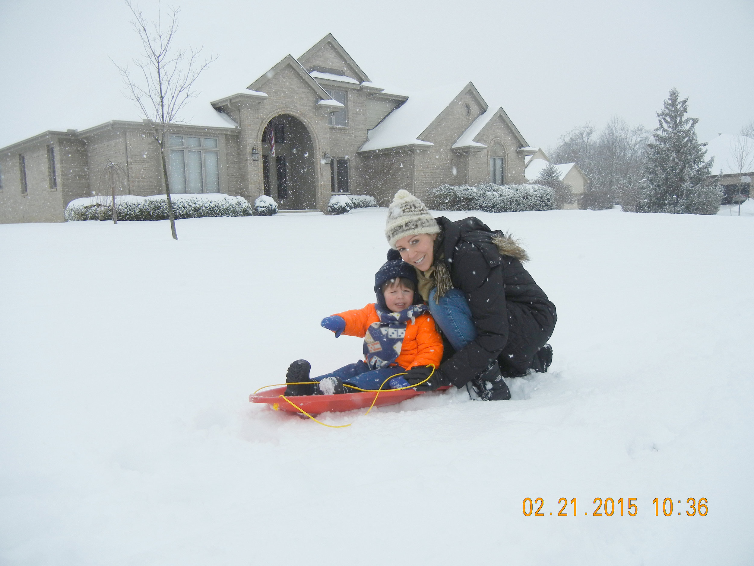 Sled in front of house adj.jpg