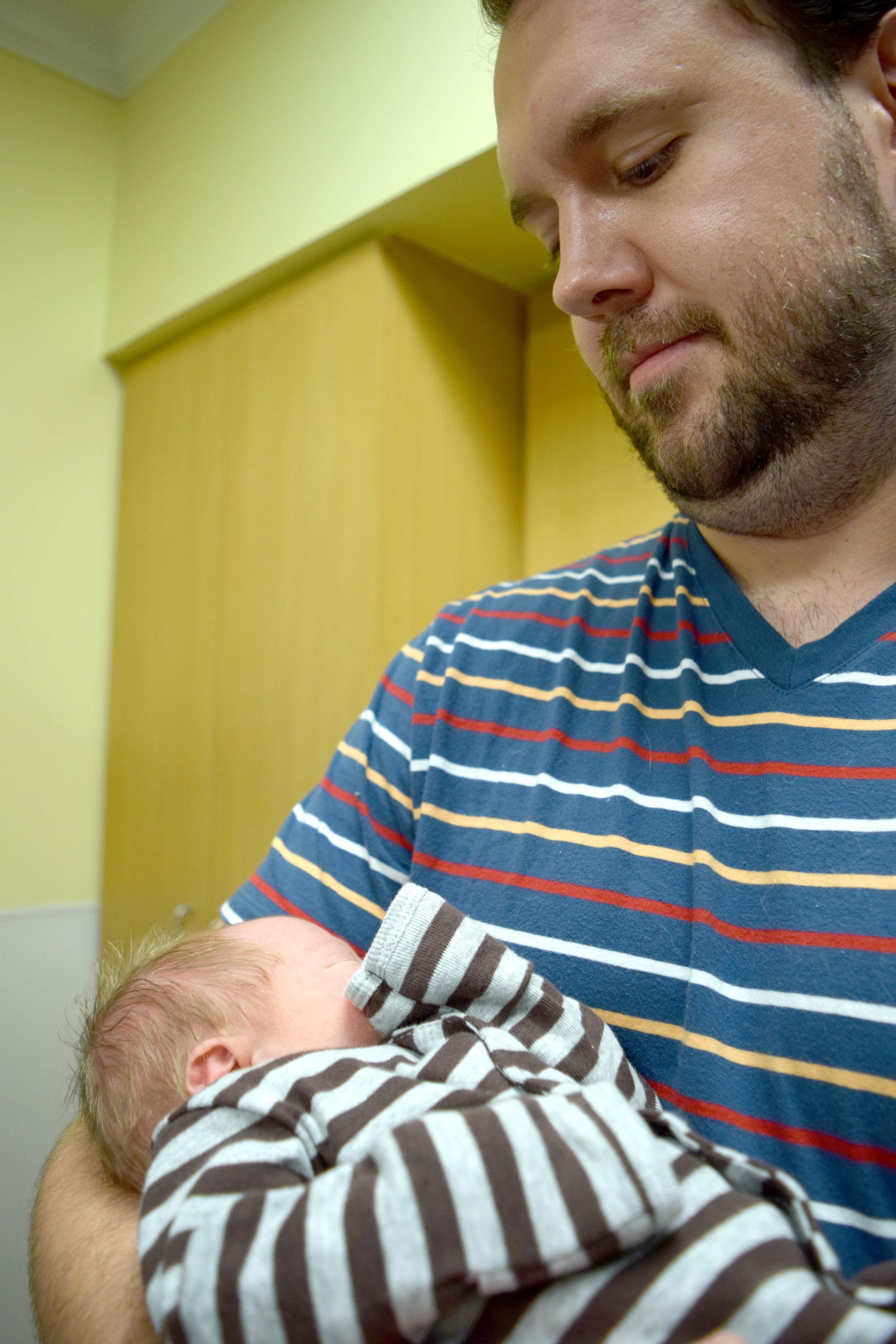 Holding our nephew for the first time at the hospital.