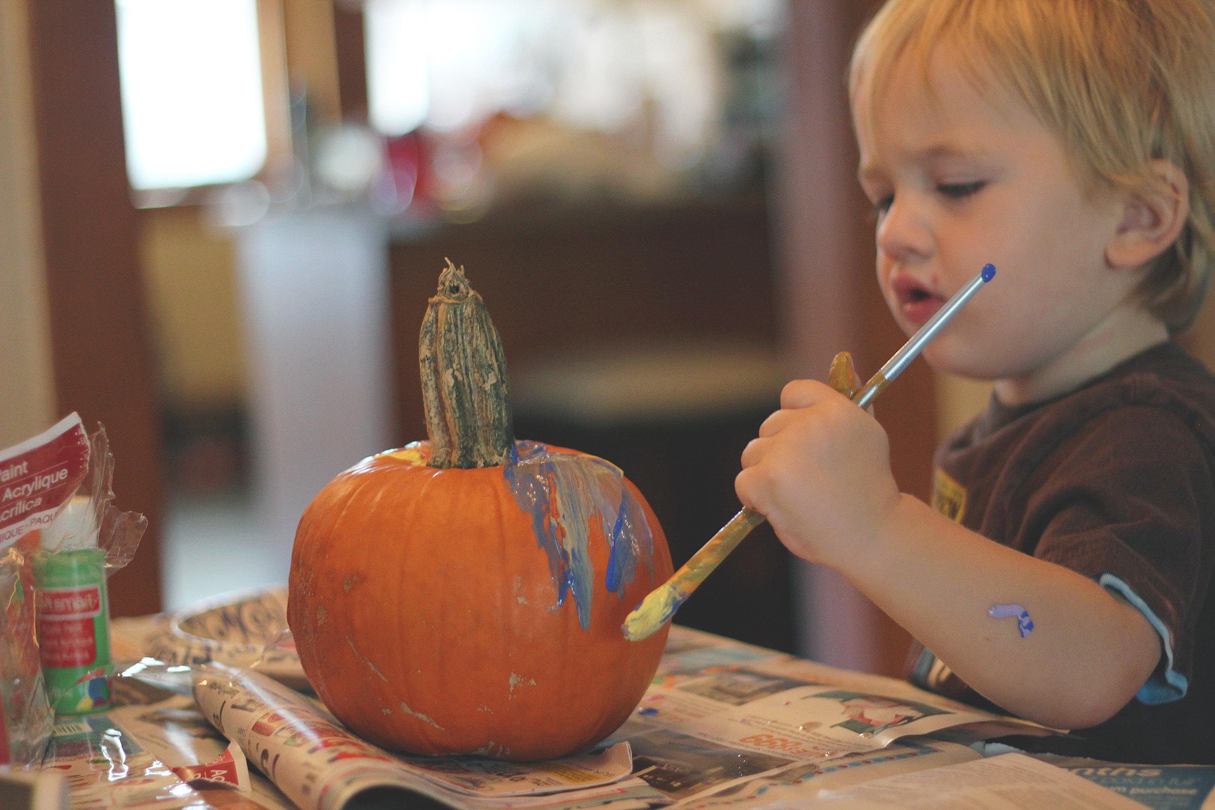 Painting pumpkins for Halloween