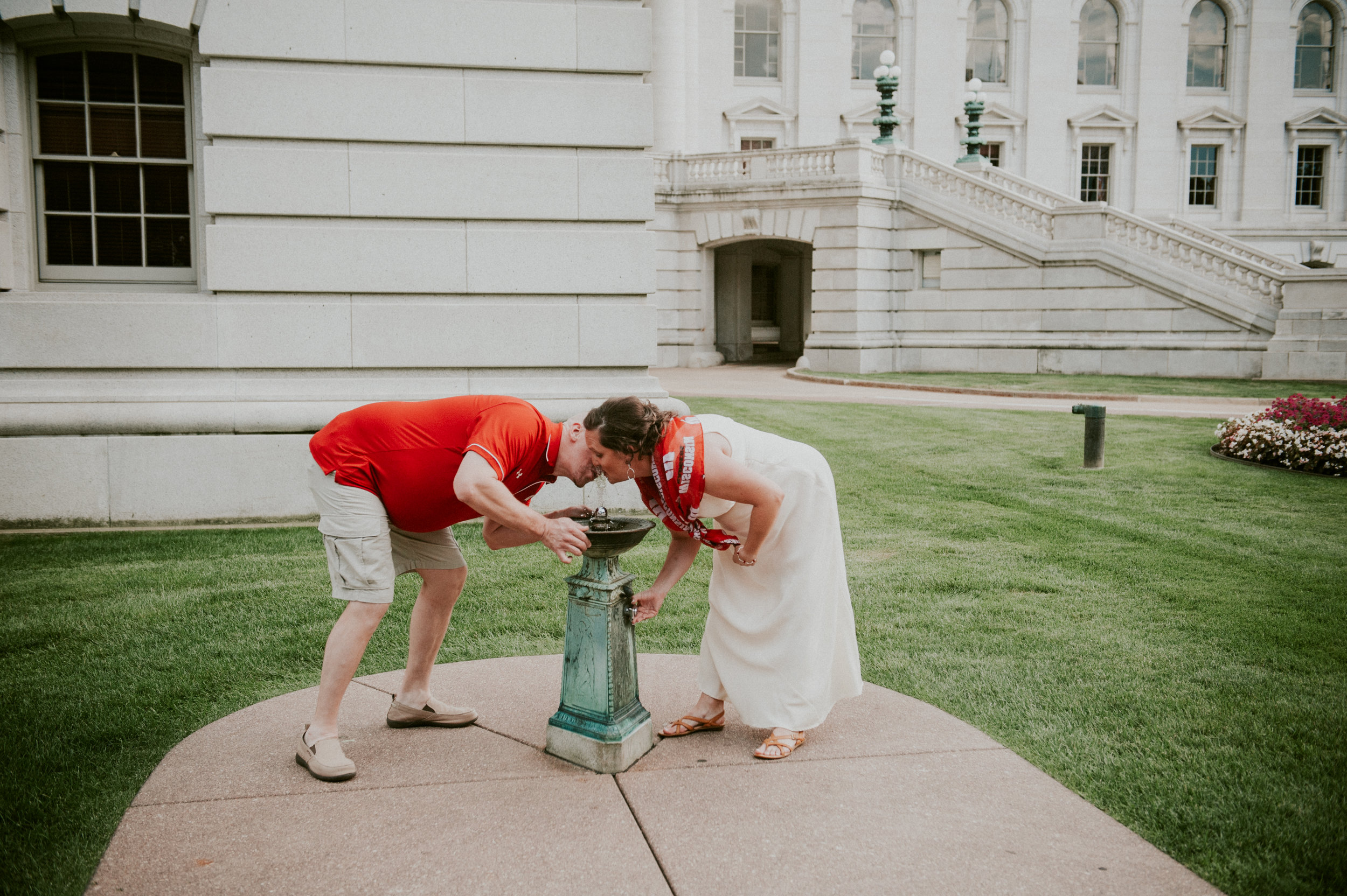 Sharing a sip of water at a historic fountain on campus